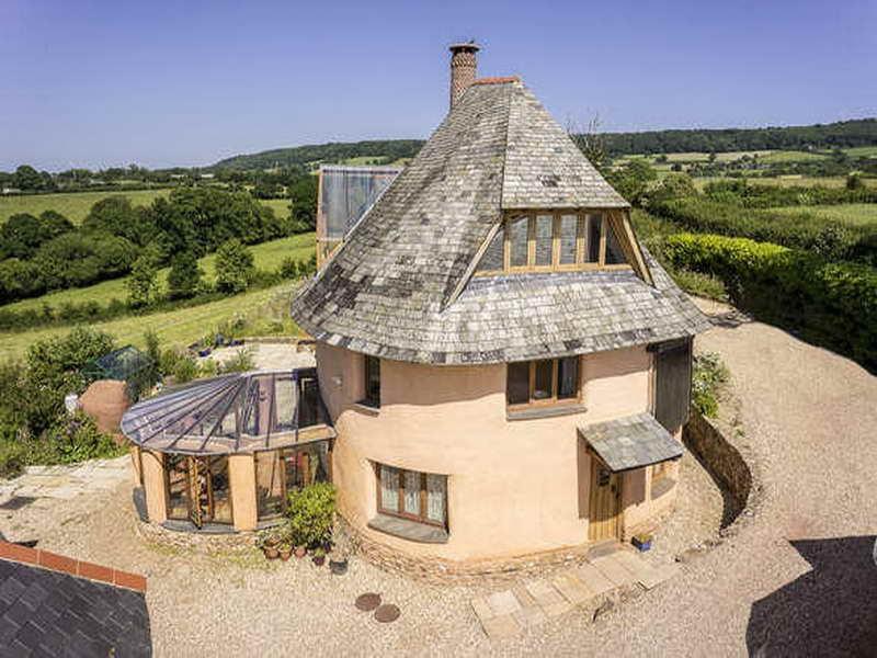Cob kirk nielsen for Round house designs plans